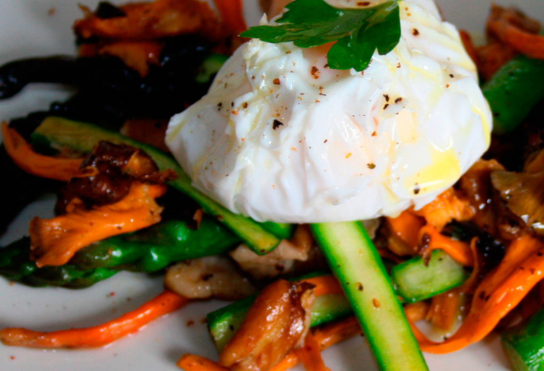 Boletus with vegetables and poached egg